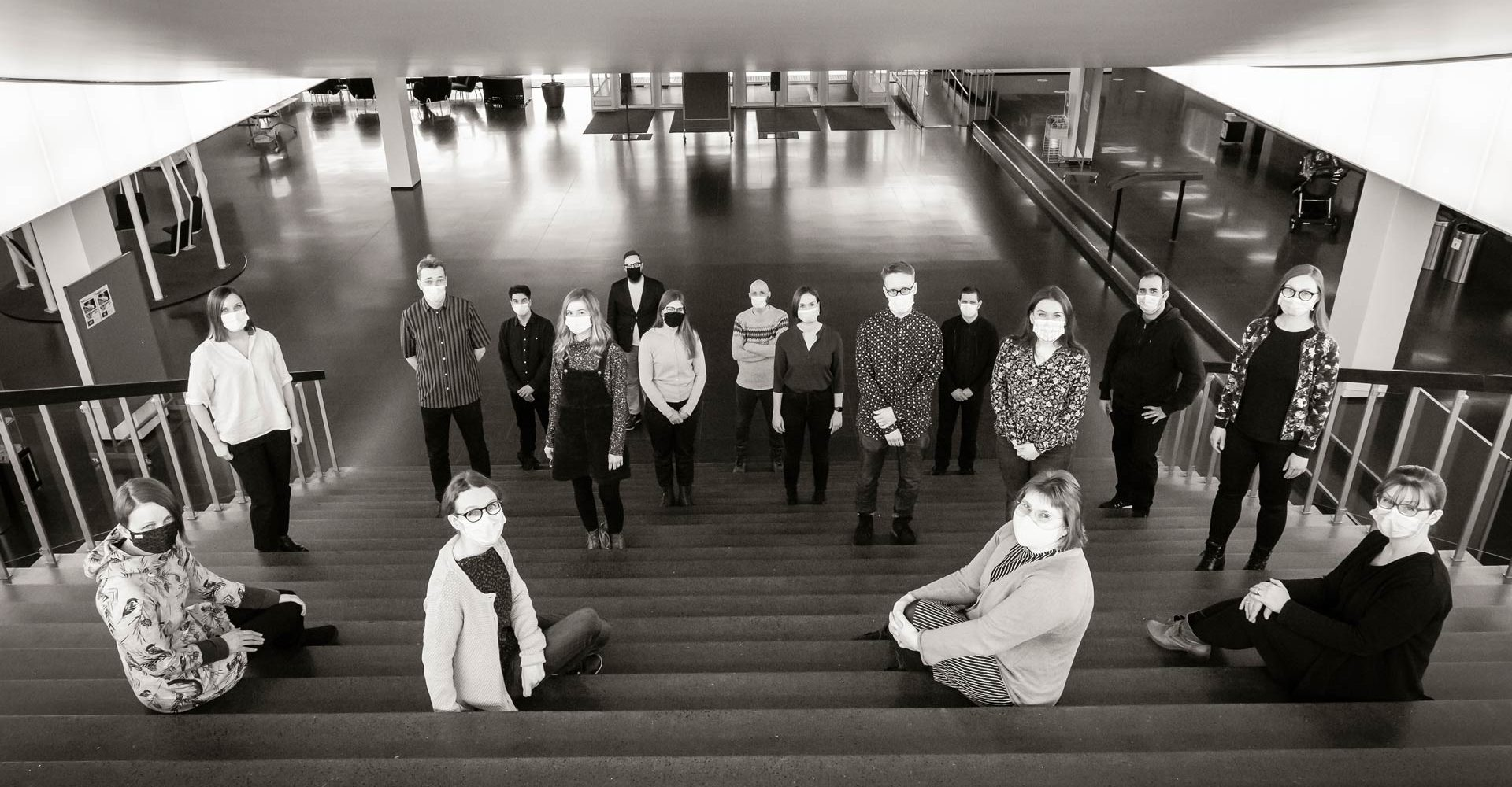 TaSSu group sitting and standing on the steps of the University